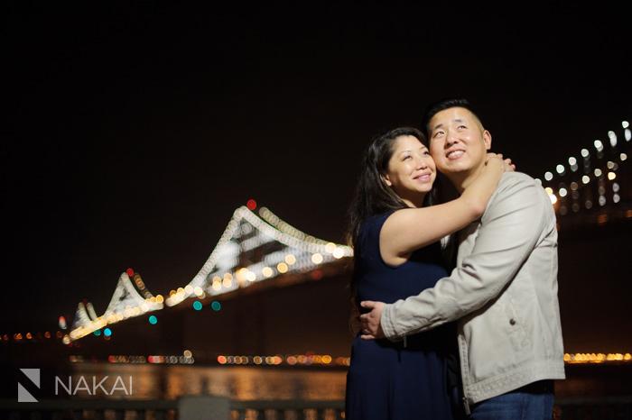 San Francisco bay bridge rincon park engagement picture at night