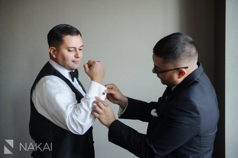 loews ohare chicago wedding photographer getting ready groom