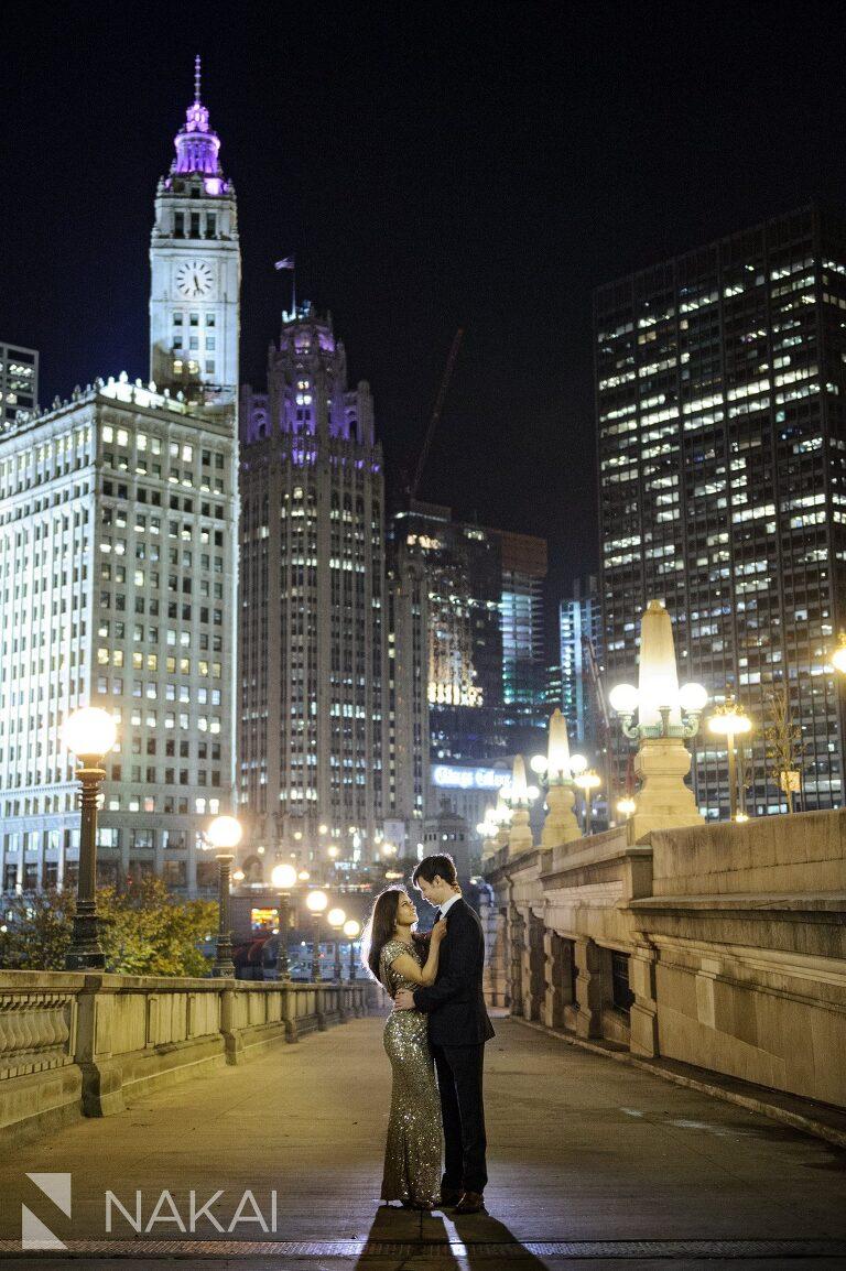night time chicago engagement photo riverwalk