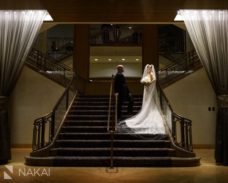 fairmont chicago wedding photographer staircase bride groom