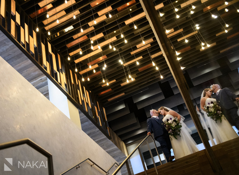 hotel at midtown Chicago wedding photos bride groom