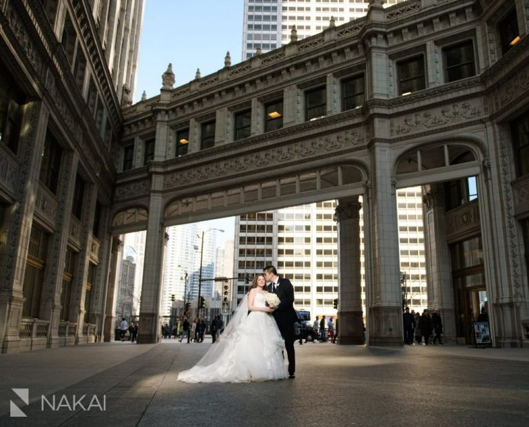 Wrigley building Chicago wedding photo bride groom kiss