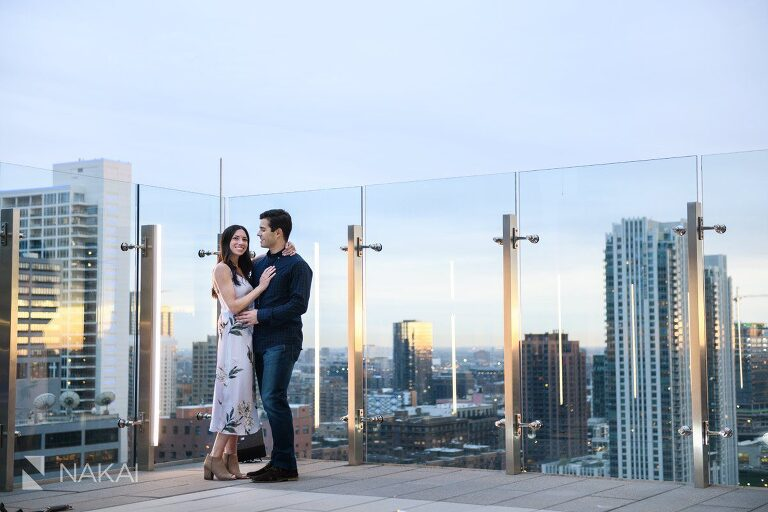 Chicago rooftop engagement couple setting sun
