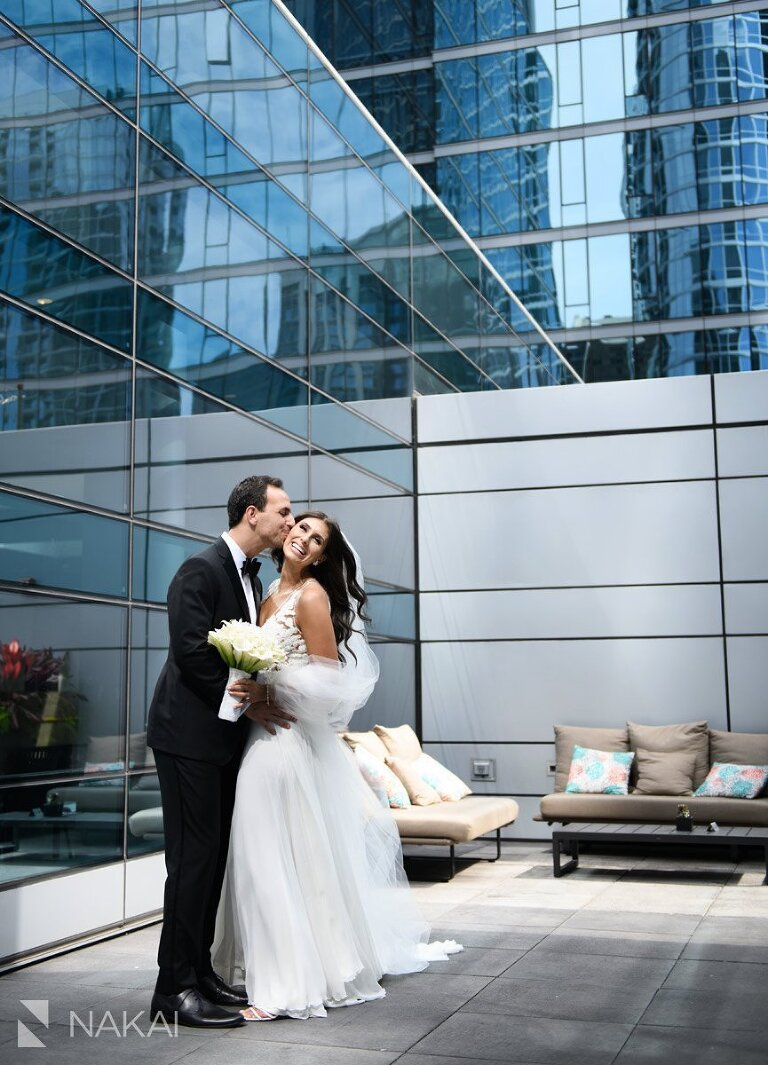 best chicago wedding photographer loews hotel rooftop bride groom