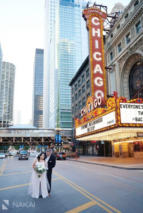 chicago intimate wedding photos chicago theatre sign